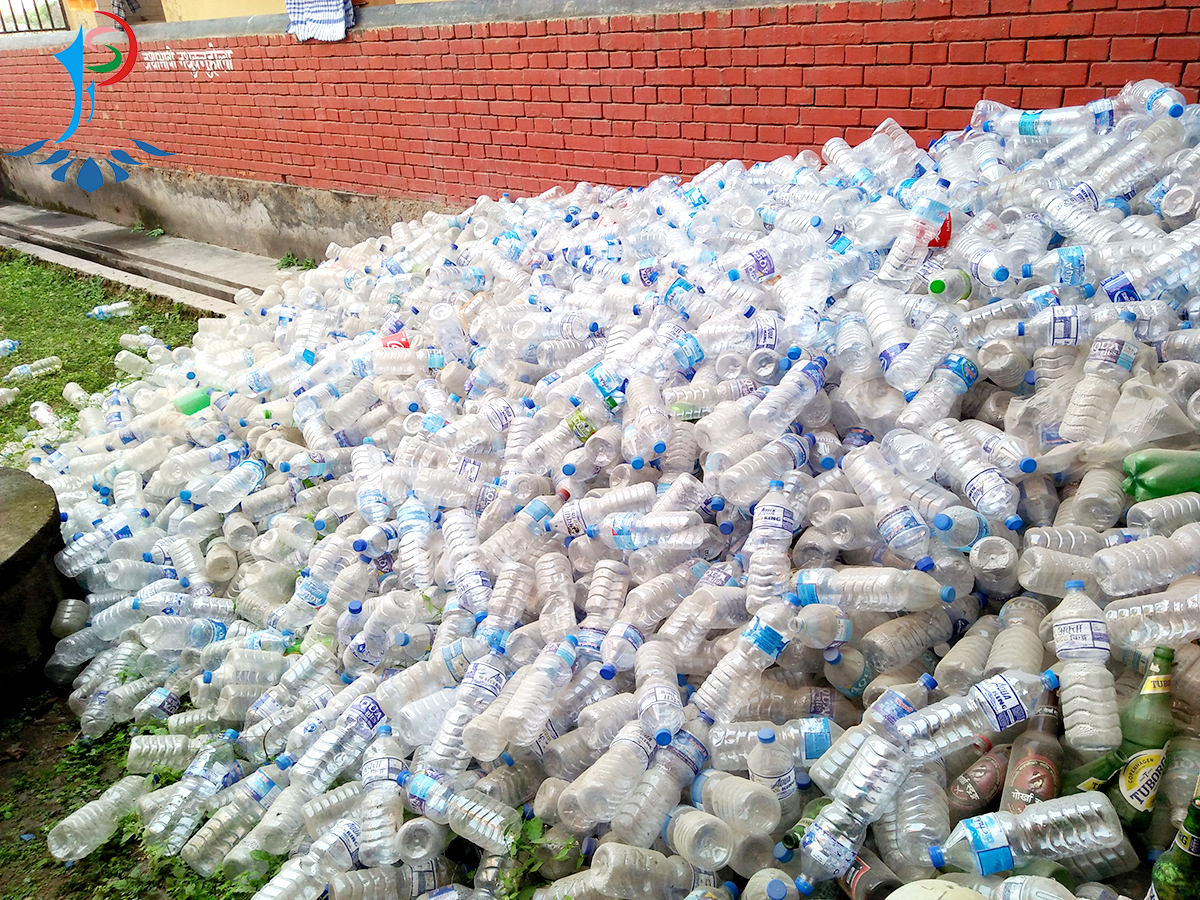 A pile of used water bottles: Dipendra Kanu
